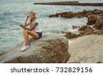 Beautiful Blonde Woman Sitting...