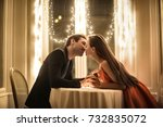 sweet couple kissing in a... | Shutterstock . vector #732835072
