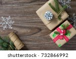 Small photo of Christmas background with gift box. Christmas gifts in handmade boxes on a wooden table. Top view with copy space. Copy space.
