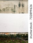 Small photo of Aged weathered brown and white street wall with afresh layer of paint