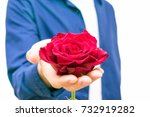 The Man Holds Out A Red Rose