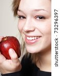 A happy young woman stays healthy by eating some ripe fruit. - stock photo