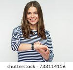 smiling woman looking at watch. ... | Shutterstock . vector #733114156