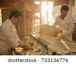 in an artisan bakery  a baker... | Shutterstock . vector #733136776