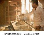 in an artisan bakery  a baker... | Shutterstock . vector #733136785
