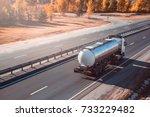 fuel tanker truck. on the road. | Shutterstock . vector #733229482