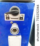 Small photo of closeup of air pressure switch with lock and unlock options
