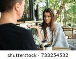 confused young woman gesturing... | Shutterstock . vector #733254532
