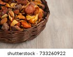 dried fruits in a wicker cup....   Shutterstock . vector #733260922