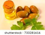 green olives in oil. | Shutterstock . vector #733281616