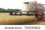 Small photo of The combine harvests wheat agriculture. Agriculture harvesting combine harvester. steadicam video shot motion