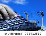 hand using a calculator on... | Shutterstock . vector #733413592