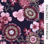 Seamless pattern  with decorative flowers and leaves on a dark background.
