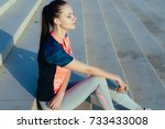 girl in sports clothes sitting... | Shutterstock . vector #733433008