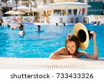 woman wearing hat in swimming... | Shutterstock . vector #733433326