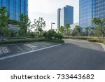 empty road with modern... | Shutterstock . vector #733443682