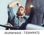 businessman throwing paper in... | Shutterstock . vector #733449472
