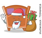 santa cute bed character cartoon | Shutterstock .eps vector #733464616