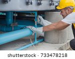 the worker wearing the yellow... | Shutterstock . vector #733478218
