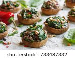 stuffed mushrooms with spinach... | Shutterstock . vector #733487332