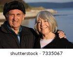 a mature couple enjoy a walk by ... | Shutterstock . vector #7335067