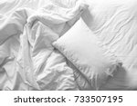 messy bed. white pillow with... | Shutterstock . vector #733507195