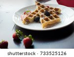 fresh waffles with strawberries ... | Shutterstock . vector #733525126