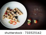 fresh waffles with strawberries ... | Shutterstock . vector #733525162