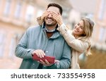 woman surprising his boyfriend... | Shutterstock . vector #733554958