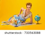 woman with a world map and... | Shutterstock . vector #733563088