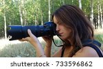 girl with camera with long lens.... | Shutterstock . vector #733596862