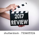 2017 review. female hands... | Shutterstock . vector #733605526