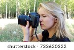 blond girl making photos with... | Shutterstock . vector #733620322