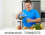 male athlete making juice or... | Shutterstock . vector #733682272