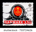 Small photo of MOSCOW, RUSSIA - OCTOBER 3, 2017: A stamp printed in Denmark shows Royal Monogram over door of Haderslev Post Office, Europa (C.E.P.T.) 1990 - Post Office Buildings serie, circa 1990