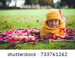 the girl with  apples on a... | Shutterstock . vector #733761262