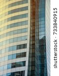 sky and building reflected in... | Shutterstock . vector #733840915