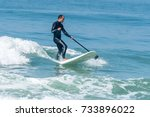stand up paddle surfer catching ...   Shutterstock . vector #733896022