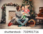 happy smiling family at a home... | Shutterstock . vector #733901716