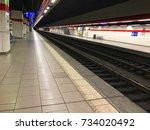 empty platform in long subway... | Shutterstock . vector #734020492
