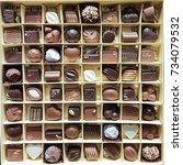 beautiful design chocolates in... | Shutterstock . vector #734079532