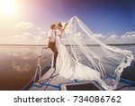 just married couple on yacht.... | Shutterstock . vector #734086762