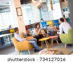 group of a young business... | Shutterstock . vector #734127016