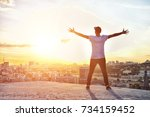 happy man with hands up on... | Shutterstock . vector #734159452