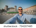 young man tourist standing on... | Shutterstock . vector #734207485