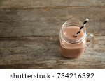 jar with tasty protein shake on ... | Shutterstock . vector #734216392