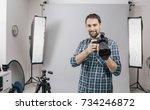 professional photographer...   Shutterstock . vector #734246872