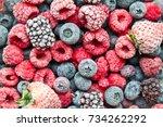 mix frozen berries background.... | Shutterstock . vector #734262292