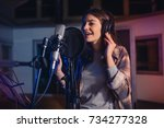 young female singer recording... | Shutterstock . vector #734277328