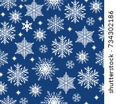 christmas seamless pattern.... | Shutterstock .eps vector #734302186